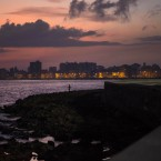 A fisherman casts his line along the Malecon at sunrise in Havana, Cuba.<span class=