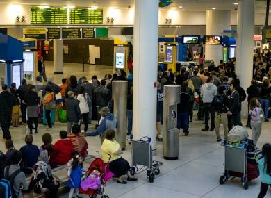 Passengers stand, most waiting for incoming flights, in the arrivals area at John F. Kennedy International Airport (JFK) in New York
