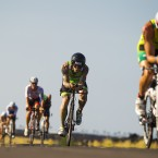 Racers hit the road during the 112-mi bike race during the 2014 IRONMAN World Championship (Marco Garcia/AP Images for IRONMAN )<span class=