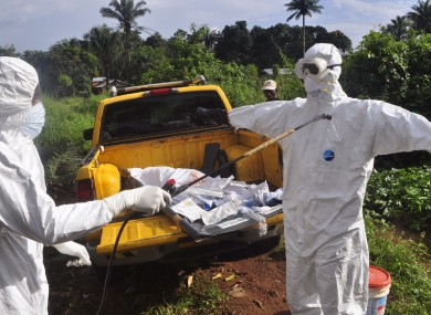 A health worker sprays disinfectant on the outskirts of Monrovia, Liberia.