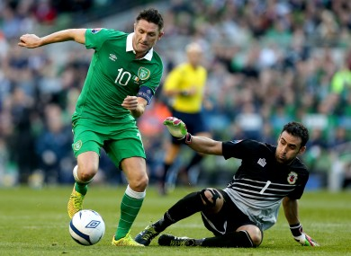 Ireland captain Robbie Keane and Gibraltar goalkeeper Jordan Perez.
