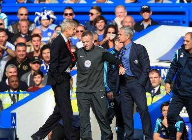 Chelsea manager Jose Mourinho (right) has a heated exchange with Arsenal manager Arsene Wenger (left) on the touchline.