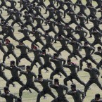 South Korean army soldiers demonstrate their martial arts skills during the 66th anniversary of Armed Forces Day at the Gyeryong military headquarters in Gyeryong, South Korea.<span class=