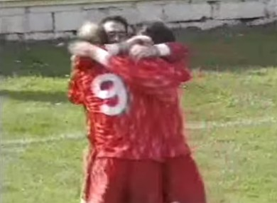 McNulty is hugged by team-mates after scoring.
