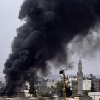 Heavy smoke from a fire caused by a strike rises in Kobani, Syria as fighting intensified between Syrian Kurds and the militants of Islamic State group, as seen from Mursitpinar in the outskirts of Suruc, at the Turkey-Syria border.<span class=
