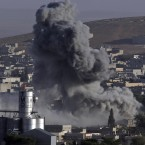 Smoke rises following an airstrike by the US-led coalition aircraft in Syria. Kobani, also known as Ayn Arab, and its surrounding areas, has been under assault by extremists of the Islamic State group since mid-September and is being defended by Kurdish fighters. <span class=