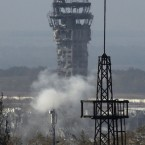 Smoke rises near the traffic control tower of Donetsk Sergey Prokofiev International Airport during artillery battle between pro-Russian rebels and Ukrainian government forces in the town of Donetsk, eastern Ukraine.<span class=