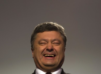 Petro Poroshenko, looking particularly happy during a press conference yesterday.