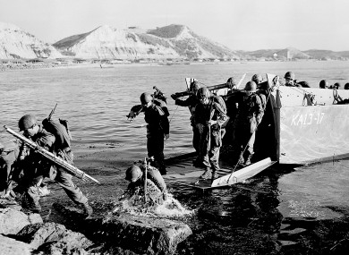 In this July 19, 1950 file photo, troops of the First U.S. Cavalry Division land ashore at Pohang on the east coast of Korea during the Korean War.