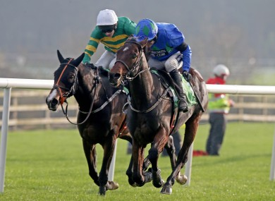 Ruby Walsh pulls away from Mark Walsh to take the victory.