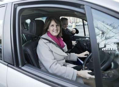 Joan Burton drives her own car to work in 2011.