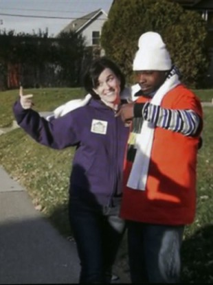 Minneapolis Mayor Betsy Hodges and Neighborhoods Organizing for Change employee Navell Gordon gesture while they knock on doors to get out the vote in north Minneapolis.