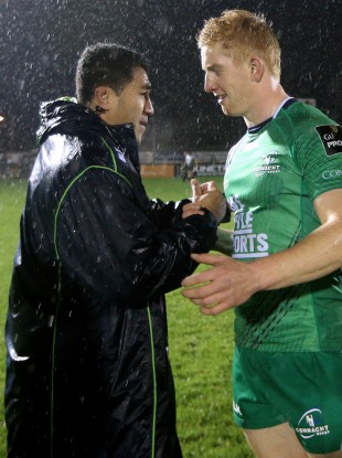 Fullback Leader is congratulated by Mils Muliaina.