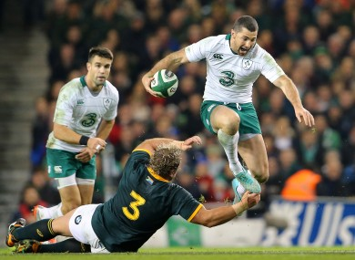 Kearney skips past Jannie du Plessis in Dublin on Saturday.