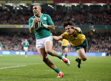 Simon Zebo races clear of Nick Phipps to score Ireland's first try.