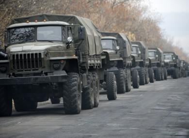 Unmarked military vehicles parked on a road outside the separatist rebel-held eastern Ukrainian town of Snizhne, 80 kilometres from Donetsk on Saturday .