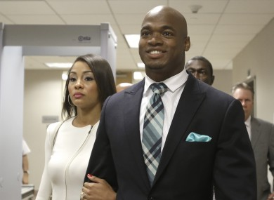 Adrian Peterson and his wife Ashley Brown Peterson leave the courthouse in Conroe, Texas.
