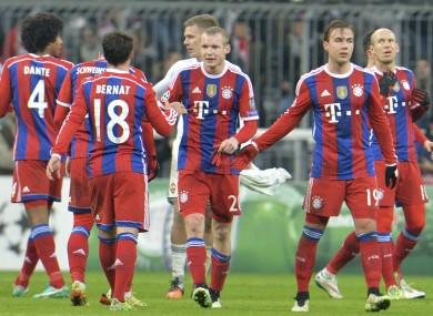 Bayern players celebrate after winning 3-0.