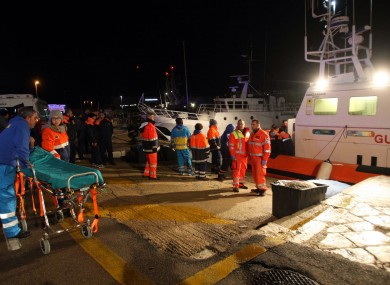 Paramedics wait for rescued passengers of the ferry that caught fire.