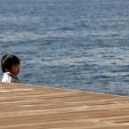 A child sees a sea in Tokyo's Daiba bay area. (AP Photo/Shizuo Kambayashi)<span class=