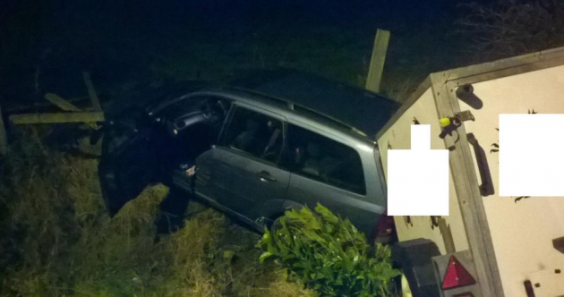 A 15 foot drop into a roadside fence … but no-one was injured in this nasty-looking crash