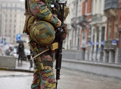 A Belgian soldier patrols in front of EU headquarters in Brussels on Monday.