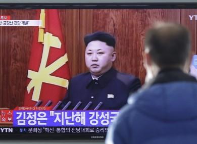 A man watches a TV news program showing North Korean leader Kim Jong-Un's New Year speech.