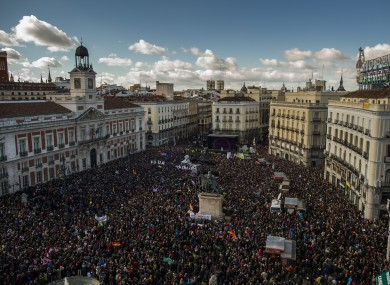 People arrive to the main square of Madrid during a Podemos (We Can) party march in Madrid.