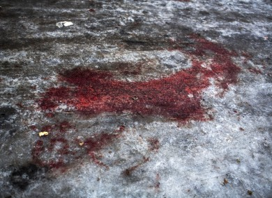 Blood from a DNR soldier killed at Donetsk airport is seen at the gate of the morgue of Kalinisky Hospital.