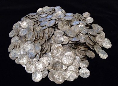 The buried treasure of coins one man found with his metal detector.