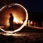 In this photo taken with a long exposure photo, a silhouetted child spins a ball of fire during rituals in celebration of Mesni Zagovezni (Shrovetide) in the village of Lozen near the capital Sofia. People in the region believe they can chase away evil spirits by performing fire rituals on Mesni Zagovezni. (AP Photo/Valentina Petrova)<span class=