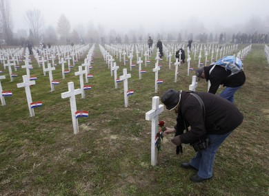 People lay flowers on crosses at Vukovar's memorial cemetery, on the 20th anniversary of the fall of Vukovar. The border city saw intense fighting in 1991.
