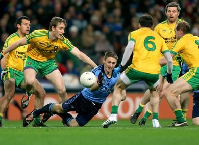 Eoghan O'Gara is swarmed by the Donegal blanket.