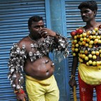 Hindu devotees, their bodies pierced with lemon and paladai, or bowl with a spout mainly used to feed milk to infants, wait to participate in a procession to mark Shivratri, or the night of Shiva, in Chennai, India. Such processions are held as an offering and show of devotion by devotees on the day dedicated to the worship of Lord Shiva, the Hindu god of destruction. (AP Photo/Arun Sankar K)<span class=