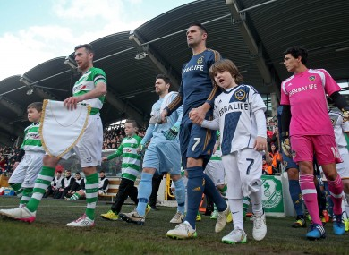 The captains lead their teams out at Tallaght Stadium.