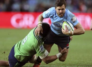 Manu tackles Adam Ashley-Cooper in a Super Rugby match.