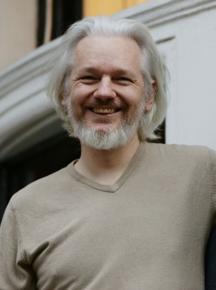 Assange, on the balcony of the Ecuadorian Embassy last November.