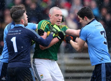 Kieran Donaghy tussles with Dublin's Sean Currie and Rory O'Carroll.