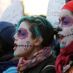 Human-rights campaigners stage a demonstration outside Downing Street at the start of President Enrique Pena Nieto's state visit to the UK.<span class=