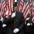 Firefighters carrying 343 American flags representing each of their colleagues who died during the terrorist attacks on the World Trade Center, march up Fifth Ave. during the St. Patrick's Day Parade in New York. (AP Photo/Mary Altaffer)<span class=