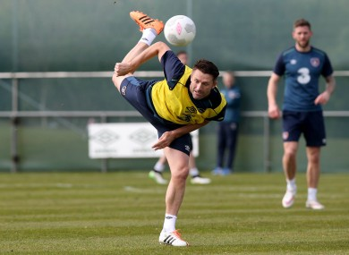 Keane flicks the ball over his head during this week's training camp.