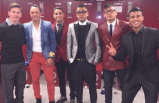 Somehow, Lionel Messi is the second best dressed person in this photo