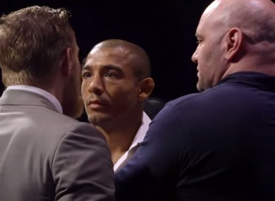 UFC president Dana White (right) keeps Conor McGregor and Jose Aldo apart during Friday's staredown in Rio.