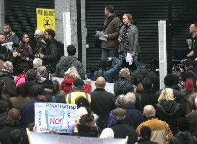 Protesters listen to Ruth Coppinger TD outside Irish Water's HQ.