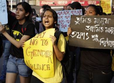 A girl shouts slogan as she participates in a walk protesting violence against women in Kolkata, India.