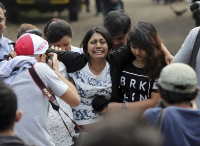 Brintha Sukumaran, centre, sister of Myuran Sukumaran, an Australian on death row, cries as she makes her way to the prison island of Nusakambangan to say her final goodbye to her brother.