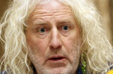 Mick Wallace claims a Fine Gael TD's court summonses are being 'kept on the shelf'