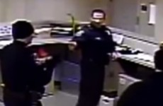 Police fist-bump in station after assault of arrested man