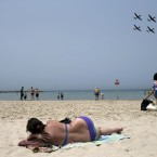 Israeli Air Force Fuga aircrafts fly over the coastline during training for Israel's upcoming Independence day, in Tel Aviv.<span class=