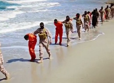 This undated image made from a video released by Islamic State militants, Sunday, April 19, 2015, shows a group of captured Ethiopian Christians taken to a beach before they were killed by Islamic State militants, in Libya.